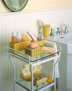 Vintage Planter Shelves - Vintage planters are a playful spin on more traditional bathroom accessories. Displayed on a metal-and-glass table, they hold bottles of shampoo and liquid soap, sponges, bar soap, and hand towels. Tuck a new toothbrush, soap, and a washcloth into a planter and put it in the bathroom cupboard -- you'll have the perfect guest package ready at a moment's notice.
