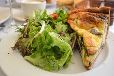 The quiche du jour, a slice of mushroom and goat cheese quiche served with a side salad from brunch at Bistrot Zinc in Chicago.