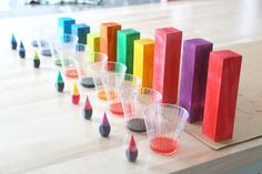 Stain unfinished wooden blocks with food coloring and rubbing alcohol. Safer than liquid water colors.
