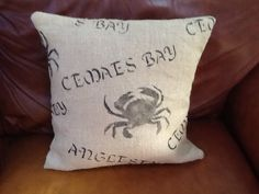 Cushion made from hand printed hessian/ burlap fabric.