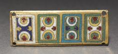 Plaque from a Reliquary Shrine, c. 1170 Germany, Rhine Valley, Cologne, Romanesque period, 12th century gilded copper; champlevé and cloisonné enamel, Overall - h:2.70 w:7.20 cm (h:1 1/16 w:2 13/16 inches). Purchase from the J. H. Wade Fund 1961.27 Cleveland Museum of Art