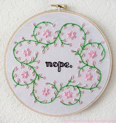 """needlepoint """"nope"""" with flowers and vines. LOVE."""
