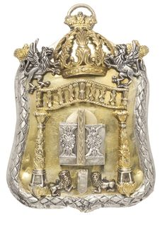 POLISH PARCEL-GILT SILVER MINIATURE TORAH SHIELD cartouche form applied with columns joined by a balustrade above doors opening to reveal a...