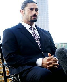 Roman looking all GQ...Damn!