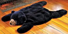 Soft rustic bear skin area rug for the rustic log cabin theme baby nursery room