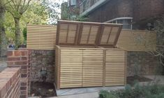 triple bay binstore with matching slatted panels