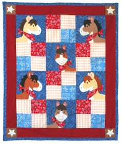 """Pony Tales quilt pattern measures 31 1/2"""" x 40"""". Can be expanded to 63 1/2"""" x 77"""" by adding additional borders. Instructions for both sizes are included. Wonder what """"tales"""" these ponies are telling?"""