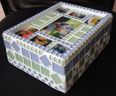 "This Box was custom made for a friend. I handmade glass tiles of photographs which I then arranged in a ""collage"" on the lid. I used Light blue and light green crystal glass tiles with white grout which I tinted a very light green."