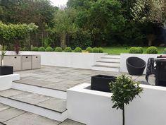 A multi level garden patio area with grey riven sandstone paving Garden Slabs, Patio Slabs, Garden Paving, Walled Garden, Garden Landscaping, Front Yard Garden Design, Garden Landscape Design, Patio Edging, Sandstone Paving