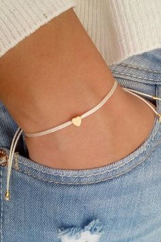 Tiny heart bracelet, wish bracelet, gold bracelet, friendship bracelet   You can wear this bracelet alone or stack it with others!  This listing is for one bracelet.  Details:  ♥ Tiny heart charm (5mm) ♥ Waxed cord ♥ The bracelet is adjustable ♥ Four gold plated beads the ending ♥ 24-25 cm fully opened. If you need a smaller or larger size please leave me a message. All my items shipping in gift packing!!!   Shipping and dispatches  This item is made to order, so allow 1-3 business days…