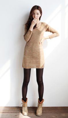 Love the winter look of the light brown dress, black tights, and brown boots.
