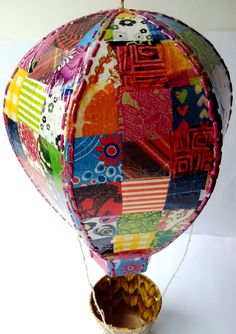 A patchwork of paper on a papier mache air balloon shape - great Decopatch/decoupage work!  All products available from us.
