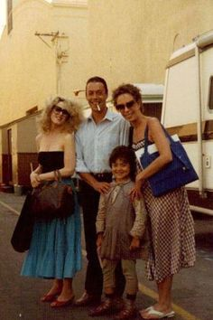 Lily St Regis (Bernadette Peters), Rooster (Tim Curry), Miss Hannigan (Carol Burnette), and Molly (Toni Ann Gisondi) in Annie 1982