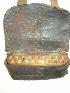 American cartridge box with two original cartridges, circa 1775. Buff leather strap.