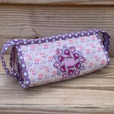 Plum Garden in all its plum-ness! I am loving this so much. 💜💜💜 Sample available Plum Garden, Quilted Cake, Sew Together Bag, Sunglasses Case, Zip Around Wallet, Photo And Video, Sewing, Pouches, Baskets