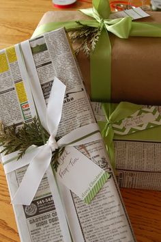 newspaper wrapping paper, inside-out grocery bags & ribbon w/ evergreen sprigs #giftwrap