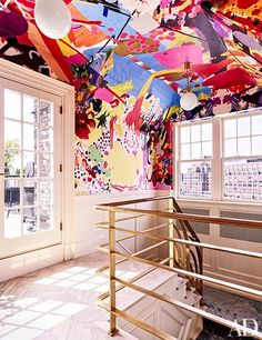 A wall covering by Assume Vivid Astro Focus animates the stairway | archdigest.com
