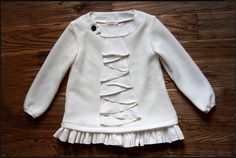 This is a little more ivory but its perfection. A dress or a sweater, this one will last for a long time in the closet!