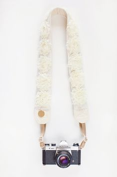 another pretty camera strap that can be made from supplies at Mary Not Martha  http://www.etsy.com/shop/MaryNotMartha  http://www.etsy.com/listing/61890815/ruffled-chiffon-rose-trim-half-yard-in
