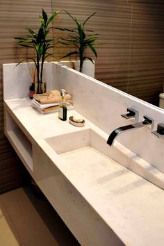 Lavabo: Banheiros minimalistas por RAWI Arquitetura + Interiores