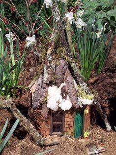 I like how this fairy house is built into the ground sort of. It makes it look like the fairy is living there and doesn't plan on moving any time soon