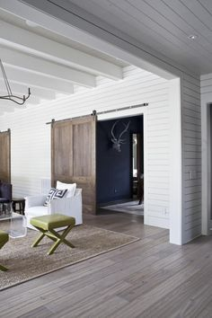 sliding wood barn doors + white wood paneling