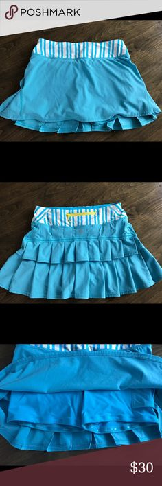 Lululemom Pacesetter Running/Tennis Skirt Like new, worn only once. Solid turquoise blue with turquoise and white vertical stripes at waist. Built in gripper shorts, tennis ball pocket and yellow zipper at back waist. Tag inside for verification. No flaws! lululemon Skirts Mini