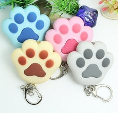 LED Light Cat Paw Keychains (With Sound). 30% proceeds from every purchase goes to animal charities.