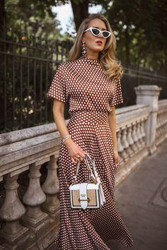 Silk polka dot maxi skirt with coordinating polka dot high neck short sleeve blouse, white pointed toe mules, white cat eye sunglasses Next Dresses, Modest Dresses, Stylish Dresses, Dresses For Work, Pretty Dresses For Women, Classic Dresses, Dots Fashion, Nyc Fashion, Fashion Models