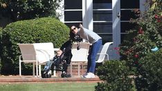 Kate, with camera at hand, makes sure George misses nothing on their stroll. Picture: New 21 April 2014