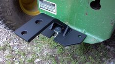 Trailer hitch bracket for lawn tractor