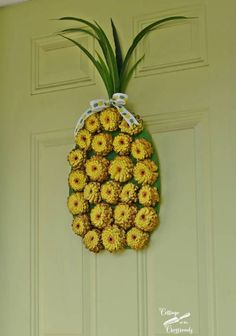 DIY some tree worthy ornaments with your kids by creating tropical pineapples out of pine cones!