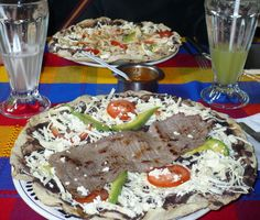 Tlayuda (Spanish pronunciation: [tɬaˈʝuða]), sometimes erroneously spelled clayuda, is a handmade dish in traditional Mexican cuisine, consisting of a large, thin, crunchy, partially fried or toasted tortilla covered with a spread of refried beans, asiento (unrefined pork lard), lettuce or cabbage, avocado, meat (usually shredded chicken, beef tenderloin or pork), Oaxaca cheese, and salsa.