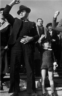 Robert capa     Man and Boy at Leftist Political Rally, Paris     1936