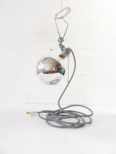 http://www.etsy.com/listing/86188584/giant-silver-bowl-clip-clamp-light-with