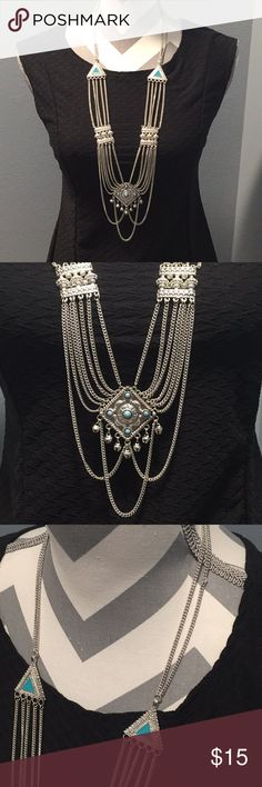 Long Silver & Blue Boho Dressy Necklace Long silvertone necklace with blue accents. Dressier, but with a boho vibe. Flaw alert: there is a kink in the chain shown in the final picture. Barely noticeable. Jewelry Necklaces
