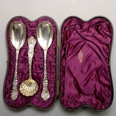 Victorian Cased Set of Three Sterling Dessert Serving Spoons. Each handle with finely chased hunting scene of dogs surrounding a stag with a hunter, the reverse with female mask and a hunting trophy; comprising two berry spoons and a sugar sifter, London hallmarks for 1880, maker's mark for Henry John Lias & James Wakely.