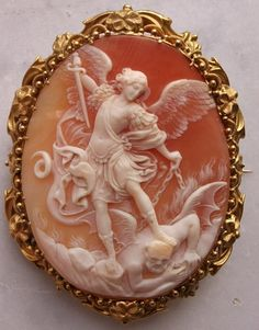 Cameo of Cornelian Shell, gold, Italy, circa Based on Baroque-style painting from 1635 by painter, Guido Reni depicting St. Michael the Archangel slaying the devil by caroline. Victorian Jewelry, Antique Jewelry, Vintage Jewelry, Cartier Jewelry, St. Michael, Saint Michael, Vintage Rosen, Kunst Online, Baroque Fashion