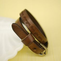Your favorite quote --- custom engraved leather buckle bracelet. $24.95, via Etsy.