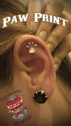 Paw print ear piercing