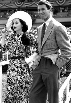 Hedy Lamarr and Jimmy Stewart attend Hollywood Park during Red Cross Day, July 1940
