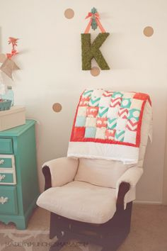 Vintage Mint and Coral Nursery with reclaimed wood décor Reveal.  Puff quilt with moss covered initial wall decor