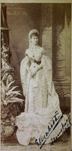 Antique cabinet photograph of Grand Duchess Elizabeth Feodorovna ( she is 21 years old) in her Russian Court dress. 1885. Ilinskoe is mentioned in the handwritten signature. It is a favourite countryside estate of Ella and her husband Sergei. Imperial  Court photographer Karl Bergamasco. #history #Russian #court #dress