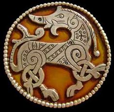Enamel Viking brooch with stylised boar design based on a decorative plaque in the Ringerike style found in Germany, 11th century.