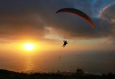 Paragliding at sunset by raphaelmelnick, via Flickr