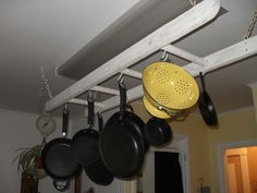 I found an old antique ladder; hung it from my kitchen ceiling with rustic boat chains; hang my pots and pans with S hooks from the round rungs. Love it and save drawer space.