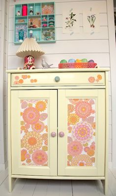 Love this idea to refresh an old cupboard and give it new life with colorful fabric or even wallpaper ... easy to do.