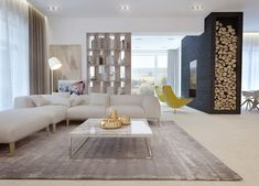 An open floor plan is a trendy description when it comes to modern homes, but the spacious main living area here looks nearly timeless. A welcoming oatmeal colored sectional sofa offers the perfect place to collapse with friends. It melds and melts into the colors of the other pieces in the room, including a brownish grey area rug, a marble topped coffee table and simple wood bookshelves.