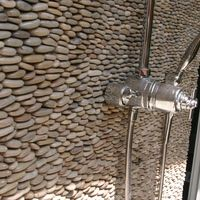 stacked pebble tiles // pool shower