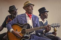"""The Jolly Boys, A Mento band. Mento is a Jamican style of folk music that pre-dates / birthed Ska & Rocksteady.    Listen to their Mento version of Amy Winehouse's """"rehab"""" here:  http://youtu.be/XOwl-bMfIkc"""